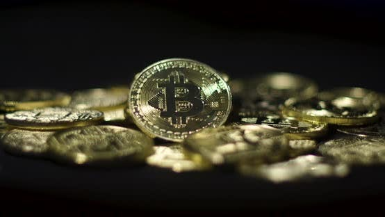 Thumbnail for Cryptocurrency Real Golden Coins With Bitcoin Logo On Black Background