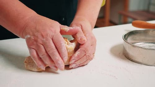 Woman Hands Forming Loaf of Bread