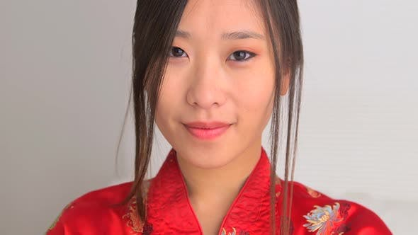 Thumbnail for Closeup of Asian woman in traditional clothing