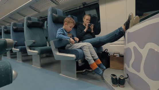 Cover Image for Mother and Kid Using Electronics During Train Ride