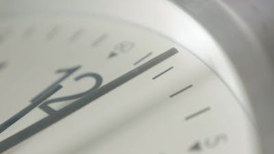 Time passing by on analog clock shallow DOF 4K 2160p UltraHD footage - Shallow DOF clock-face needle