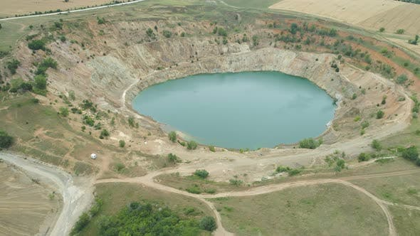 Aerial View of Abandoned Copper Mine Filled with Water, Surrounded By Fields, Tsar Asen, Bulgaria