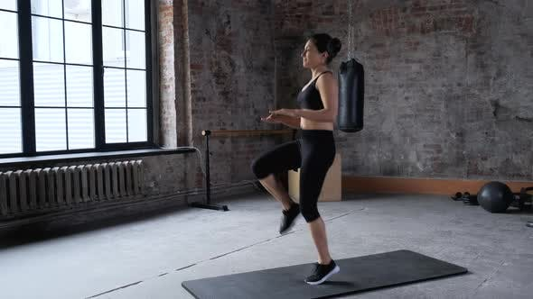 Young Indian Athletic Woman Jumps Sports Does Exercise Dressed in Sportswear Black Top
