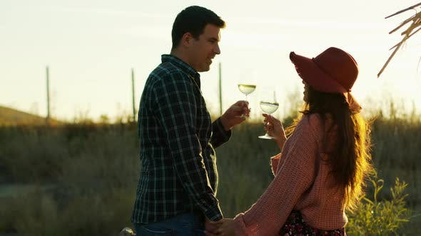 Thumbnail for Couple Holding Hands and Tasting White Wine