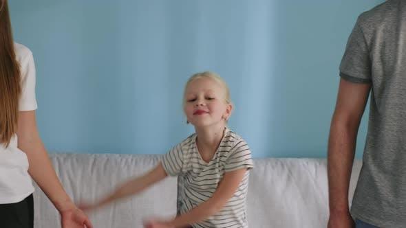 Small Girl Has Fun at Home