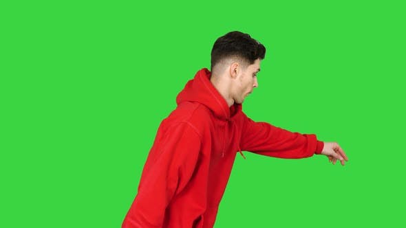 Handsome Young Man Dancing in Red Hoody on a Green Screen, Chroma Key