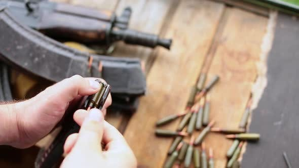 Thumbnail for Close Up of a Male Hands Charging Ammo. Shooting