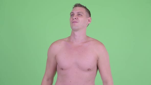 Thumbnail for Happy Shirtless Young Man Removing Sunglasses and Thinking