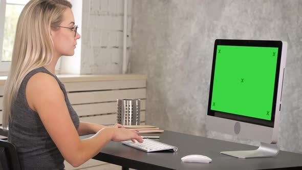 Thumbnail for Attractive Mature Businesswoman Working on Computer in Her Workstation