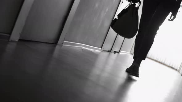 Thumbnail for Silhouette of Woman Walking in Hallway