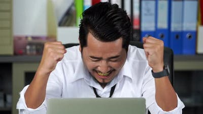 happy successful young business man using laptop computer