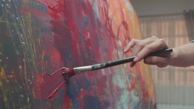 Hand Holding Paint Brush And Painting