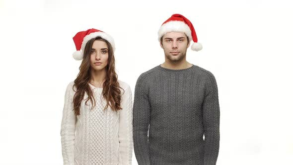 Thumbnail for Young Couple in Sweaters Showing Present and Show Shocking Expression To Camera