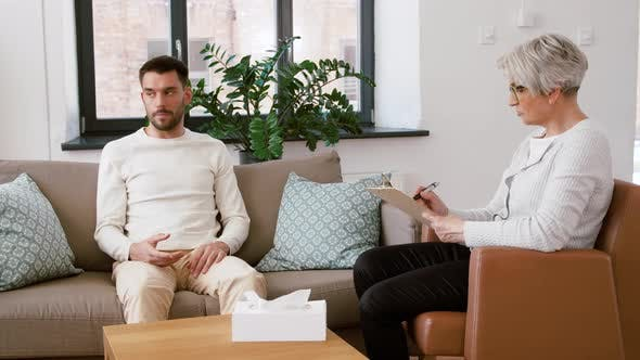 Thumbnail for Senior Woman Psychologist and Sad Man Patient