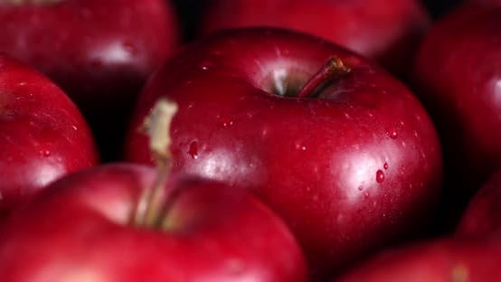 Rotating Fresh Red Apples with Water Drops