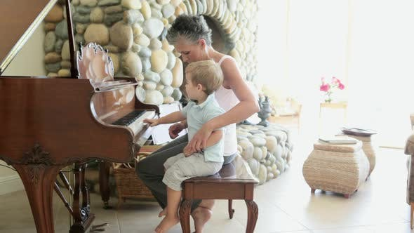 Thumbnail for Grandmother and grandson playing piano