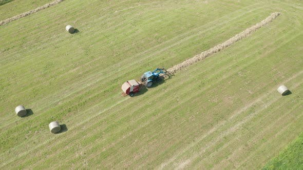 Thumbnail for Blue Tractor Hay Bales Aerial View