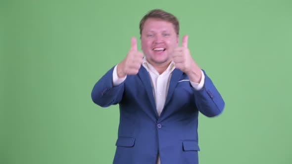 Thumbnail for Happy Overweight Bearded Businessman Giving Thumbs Up and Looking Excited