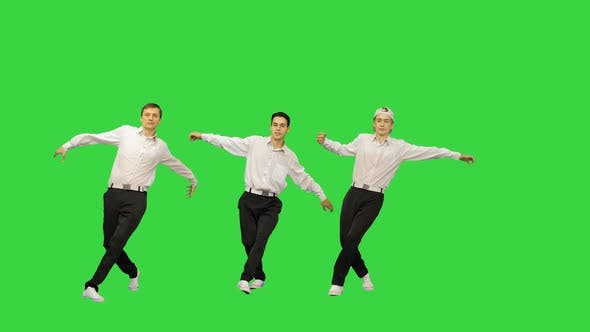 Thumbnail for Three Guys in White Shirts Dancing in Synch Looking at Camera on a Green Screen, Chroma Key.