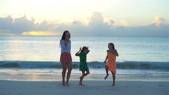 Thumbnail for Adorable Little Girls and Young Mother Having Fun on White Beach, SLOW MOTION