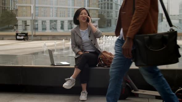 Thumbnail for Asian Woman Having Phone Call Outdoors
