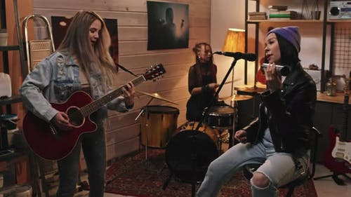 Female Music Band Performing In Studio