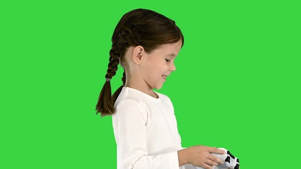 Thumbnail for Smiling Little Girl Play Videogame Holding Joystick in Her Hands on a Green Screen, Chroma Key.