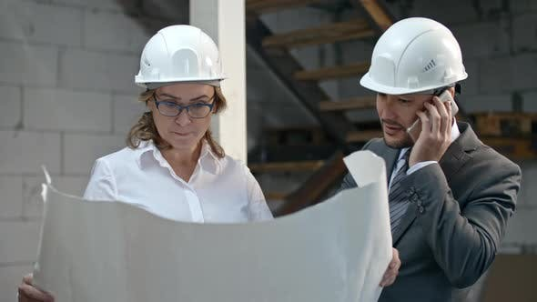 Thumbnail for Businessman and Construction Coordinator Discussing Blueprints