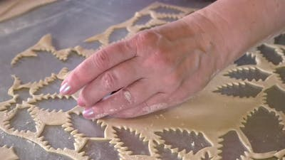 Baker Cutting Cookies with a Cookies Cutter