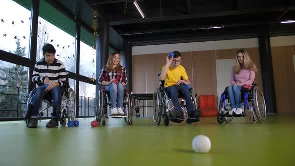 Thumbnail for Disabled People in Wheelchairs Playing Boccia