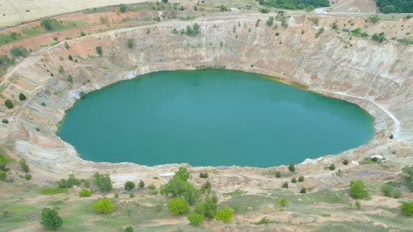 Thumbnail for Abandoned Copper Open Pit Quarry Filled With Blue Water, Drone View