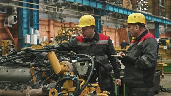 Plant Workers Inspecting Machinery