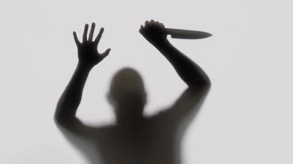 Thumbnail for Silhouette of a Knife Wielding Killer