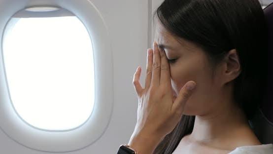 Woman feeling dizzy on airplane