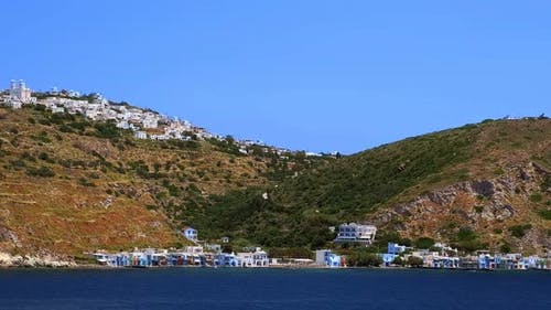 Panning View of Plaka Klima and Adamas Milos Island Greece on Clear Sunny Day