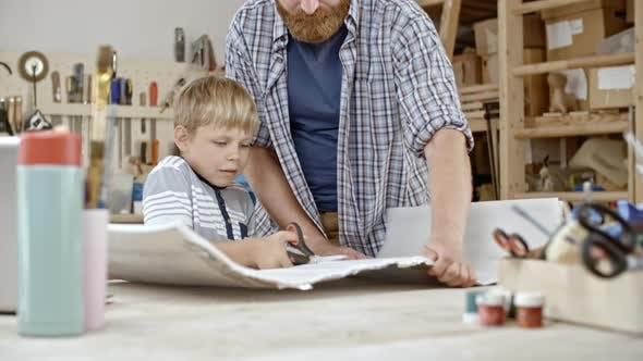 Boy Cutting Styrofoam Sheet