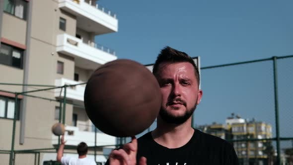 Man Spins Basketball on His Finger