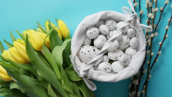 Thumbnail for Holiday Contept Decoration with Easter Eggs and Yellow Tulips Over Blue