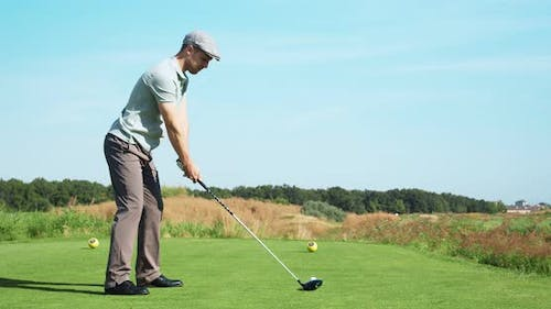 Luxury Hobby. Young Golf Player Playing at Outdoor Course, Hitting Ball
