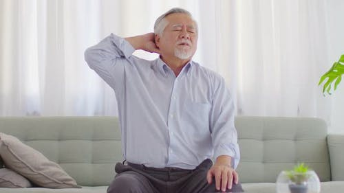 Asian Elderly senior man with white hairs neck and shoulder pain and illness
