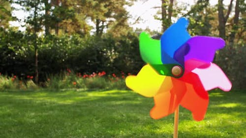 Colorful Pinwheel Rotating Outdoors in Summer