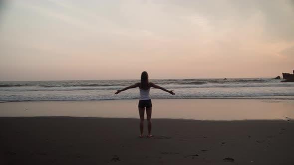 Thumbnail for Woman Meditating on Ocean Coastline at Scenic Sunset