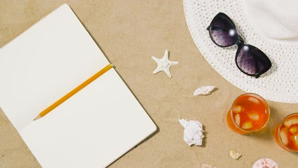 Thumbnail for Notebook, Cocktails, Hat and Shades on Beach Sand