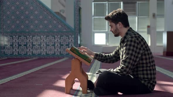 Muslim Young Man Reading Quran Mosque