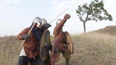 Medieval warriors in battle
