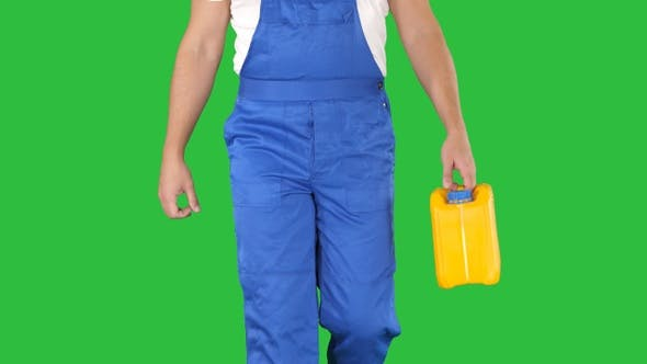 Construction worker in hard hat holding plastic canister