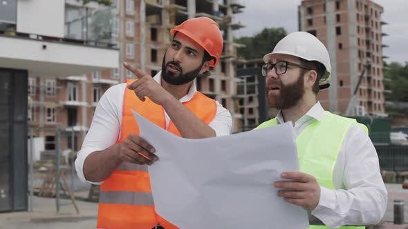 Thumbnail for Architect Expert Engineers Talking and Analyze Design Plan Standing Under Construction Site