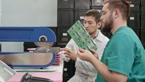 Technicians Using PCB Separator Machine