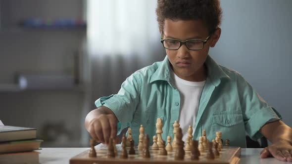 Cover Image for Smart Boy Playing Chess Carefully Thinking Through Each Move Logical Game