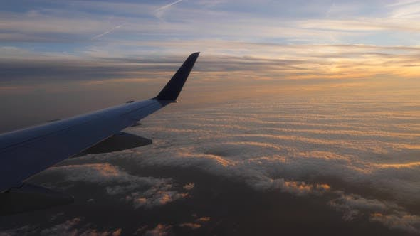 Aerial view of sunset through airplane window